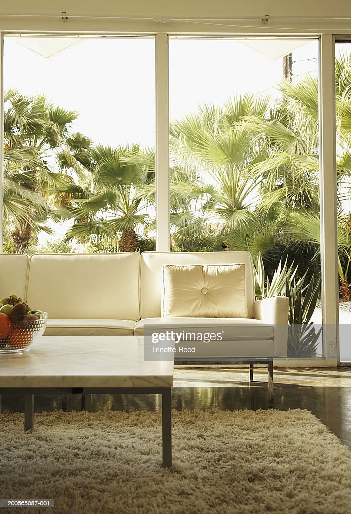 Coffee table and sofa in living room : Stock Photo