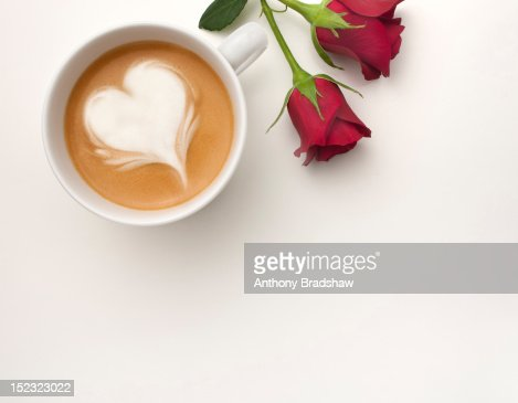 A coffee with a heart shape drawn in its foam : Stock Photo