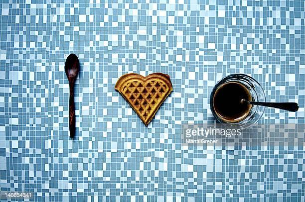 Coffee with heart shape waffle