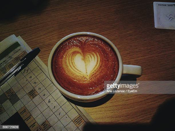 Coffee With Latte Art On Table