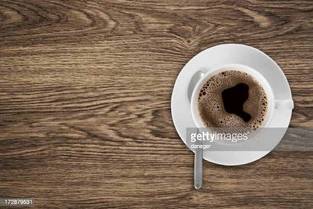Coffeecup with Coffee in it on a wooden table