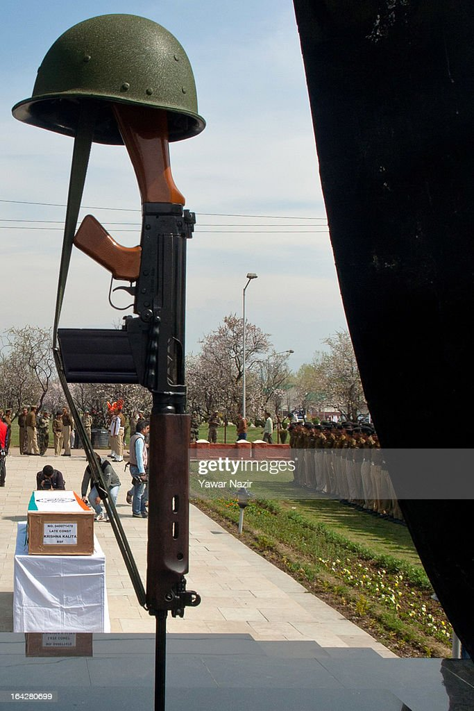 A coffin containing the body of Indian Border Security Force (BSF) soldier Krishna Kalita lies on a table during his wreath-laying ceremony on March 22, 2013 in Srinagar, the summer capital of Indian administered Kashmir, India. A wreath-laying ceremony was held by the BSF for their killed comrade after suspected rebels shot him dead yesterday and wounded two others when they fired on their vehicle on a highway. Kashmir valley is on the alert since the hanging of Afzal Guru, a local resident who was convicted of carrying out a deadly attack on the Indian Parliament in 2001.