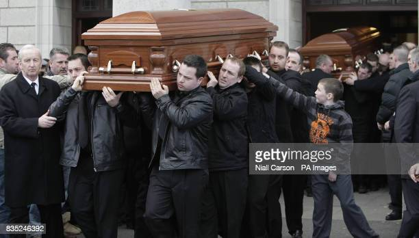 A coffin is carried out during the funeral of brothers James Anthony and Martin McDonagh at Our Lady of Lourdes Church in Drogheda The brothers died...