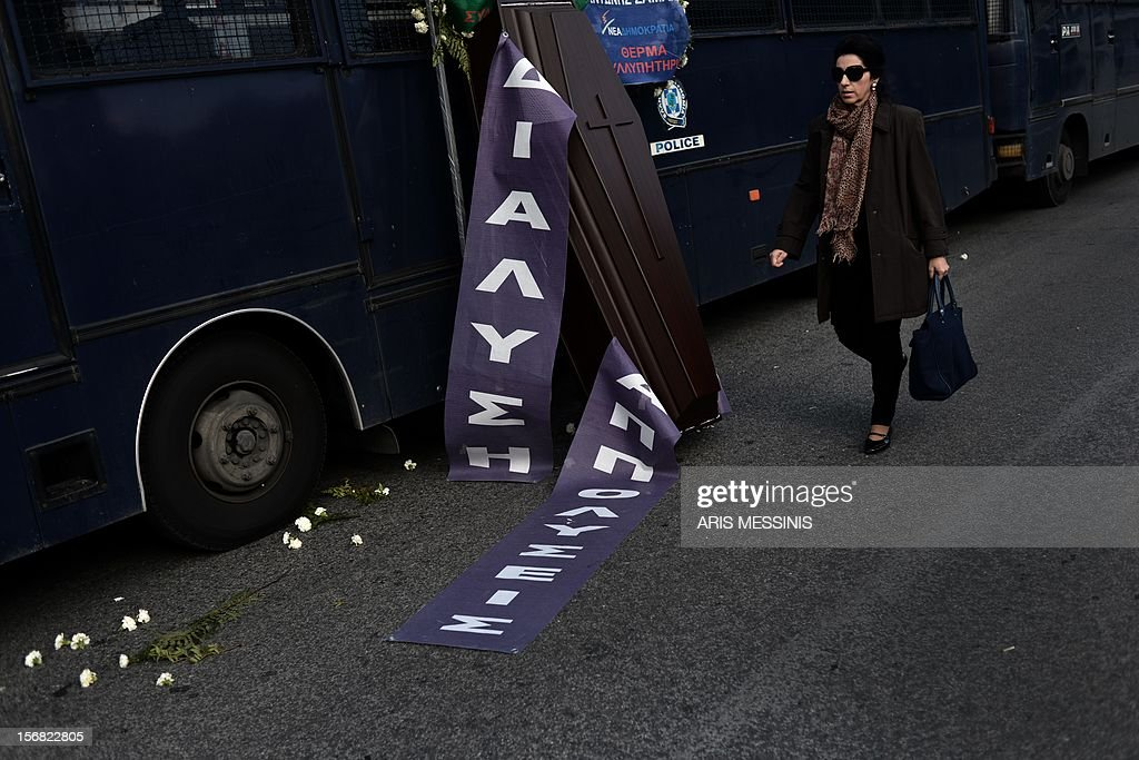 A coffin is placed outside the Interior Ministry during a demonstration of municipality workers against the new austerity measures in Athens on November 22, 2012. AFP PHOTO / ARIS MESSINIS