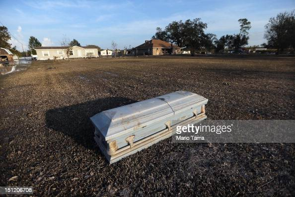 A coffin is washed up onto a front lawn due to Hurricane Isaac flooding in Plaquemines Parish on September 3 2012 in Braithwaite Louisiana Damage...