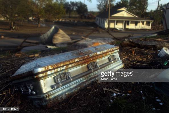 A coffin is washed up onto the side of a levee from Hurricane Isaac flooding in Plaquemines Parish on September 3 2012 in Braithwaite Louisiana...