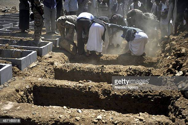 Coffin of a soldier killed in Hadramawt by an attack held by Ansar alSharia Yemenbased umbrella organization of AlQaeda is placed into his grave...