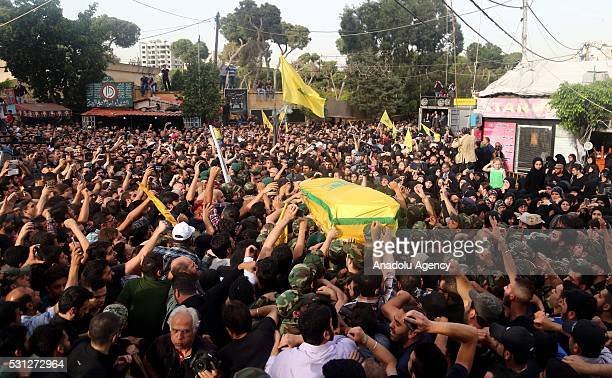 Coffin of Mustafa Badreddine a Hezbollah military commander died in an explosion near Syria's Damascus airport is being carried during the Hezbollah...