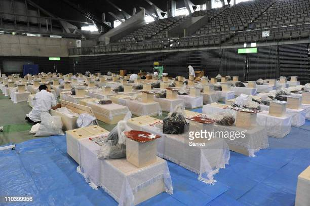 Coffins are arranged at an improvised mortuary on March 18 2011 in Rifu Miyagi Japan A massive earthquake measuring 90 on the Richter scale struck...