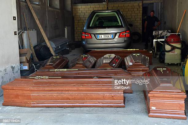 Coffins are laid out on the ground on August 25 2016 in Amatrice Italy The death toll in the 62 magnitude earthquake that struck around the Umbria...