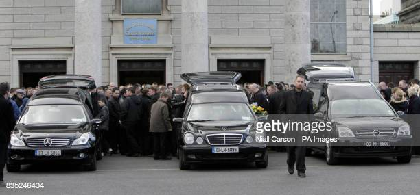 Coffins are loaded into three hearses during the funeral of brothers James Anthony and Martin McDonagh at Our Lady of Lourdes Church in Drogheda The...