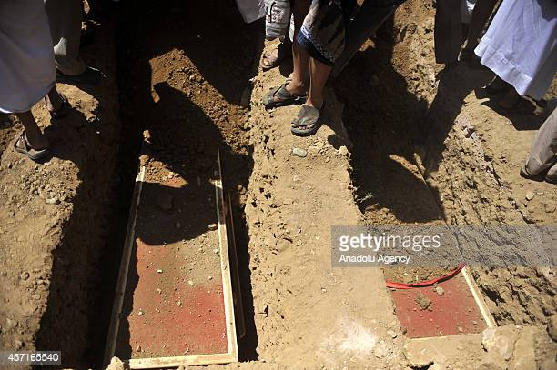 Coffins of the soldiers killed in Hadramawt by an attack held by Ansar alSharia Yemenbased umbrella organization of AlQaeda are placed into their...