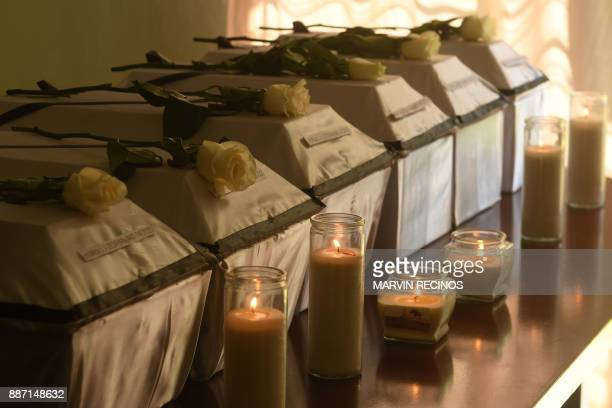 Coffins with the remains of six children victims of the 1981 El Mozote massacre are lined up to be handed over to their relatives in San Salvador on...
