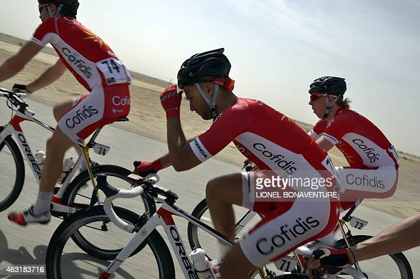 Cofidis team leader French Nacer Bouhanni rides with teamates during the fourth stage of the 2015 Tour of Qatar between alThakhira and Mesaieed on...
