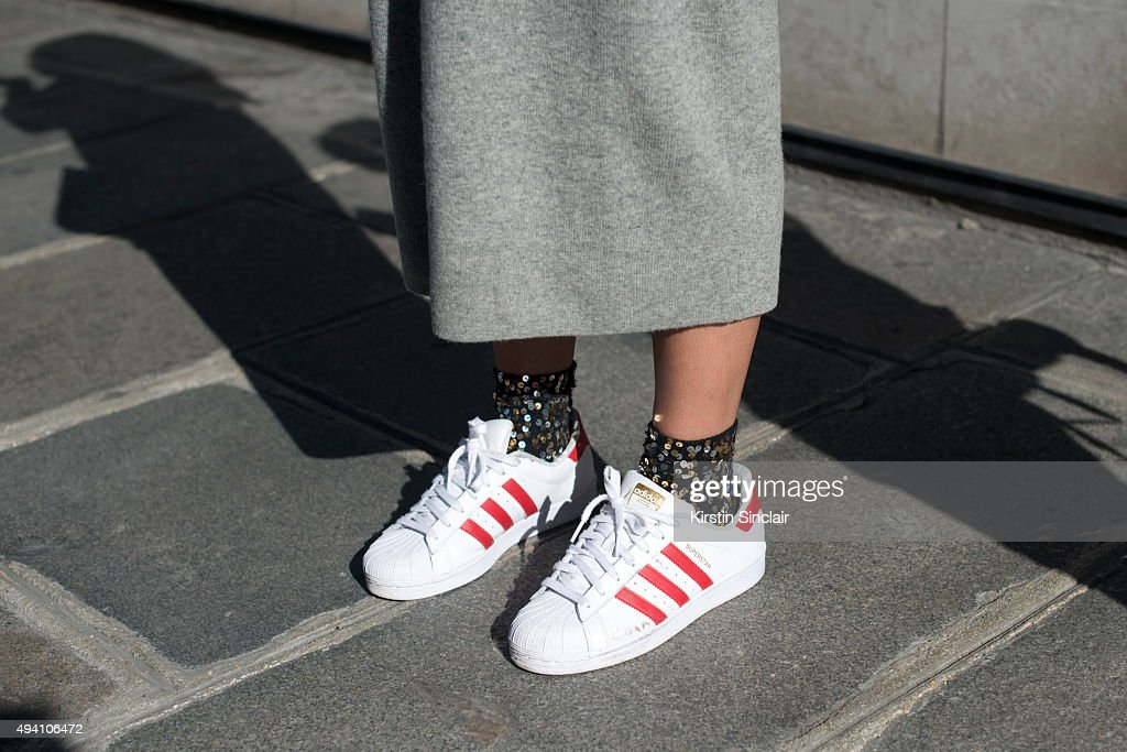 CoFounder and Fashion Editor Catherina Dietrich wears Adidas trainers H and M dress on day 3 during Paris Fashion Week Spring/Summer 2016/17 on...