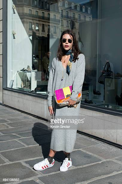 CoFounder and Fashion Editor Catherina Dietrich wears Rayban sunglasses Adidas trainers H and M dress and a Jane Moraes bag on day 3 during Paris...