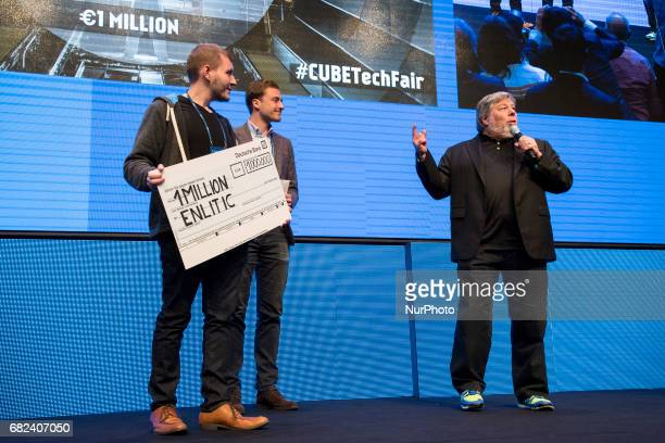 CoFounder of Apple Steve Wozniak awards Kevin Lyman and Felix BaldaufLenschen of the winning startup Enlitic at the end of the Cube Challenge Award...