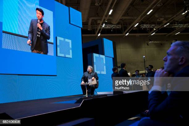 CoFounder of Apple Steve Wozniak listens to Liang Wu of the startup Green City Solutions during the Cube Challenge Finale at the CUBE Tech Fair for...