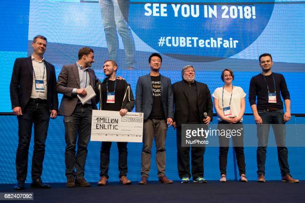 CoFounder of Apple Steve Wozniak poses with Kevin Lyman and Felix BaldaufLenschen of the winning startup Enlitic at the end of the Cube Challenge...