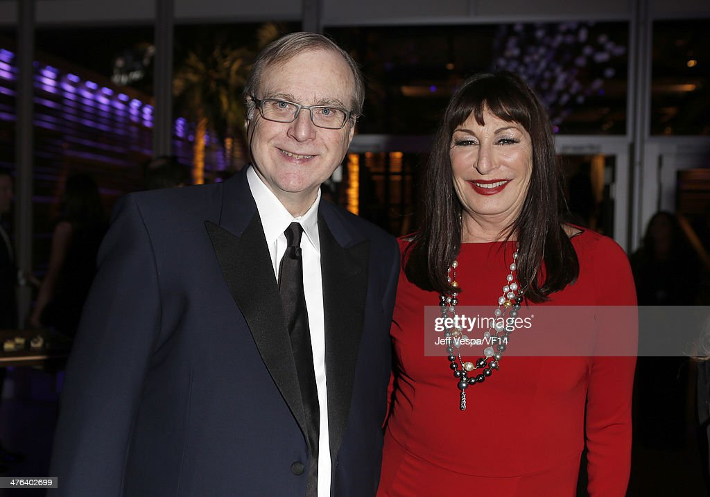 Co-founder of Microsoft Corporation Paul Allen (L) and actress Anjelica Huston attend the 2014 Vanity Fair Oscar Party Hosted By Graydon Carter on March 2, 2014 in West Hollywood, California.