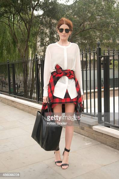 CoFounder of Reward Style and Like to Know It Amber Venz Box is wearing Rayban sunglasses Givenchy bag and blouse Erin Kleinberg jacket and skirt and...