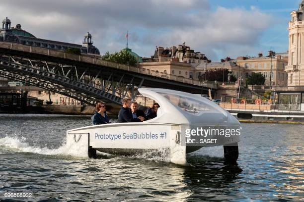 Cofounder of Sea Bubbles company French Alain Thebault and Mayor of Paris Anne Hidalgo stand on board a Bubble electric maritime 'flying taxi' during...