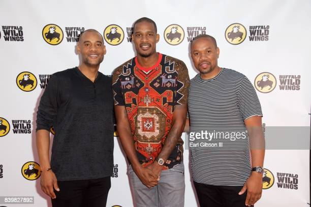CoFounder PCF Restaurant Management Karim Webb NBA Player Trevor Ariza and CoFounder PCF Restaurant Management Edward Barnett attend the Buffalo Wild...
