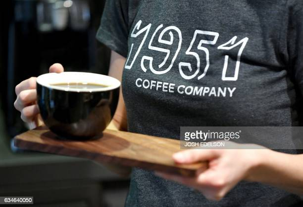 CoFounder Rachel Taber serves coffee at 1951 Coffee Company in Berkeley California on February 09 2017 The 1951 Coffee Company is a nonprofit...
