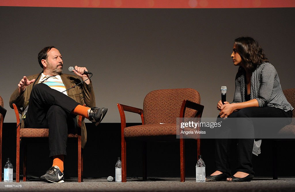 Co-Founder Submarine Entertainment Josh Braun speaks onstage as Nagwa Ibrahim (R) looks on during the Film Independent Forum at the DGA Theater on October 26, 2013 in Los Angeles, California.