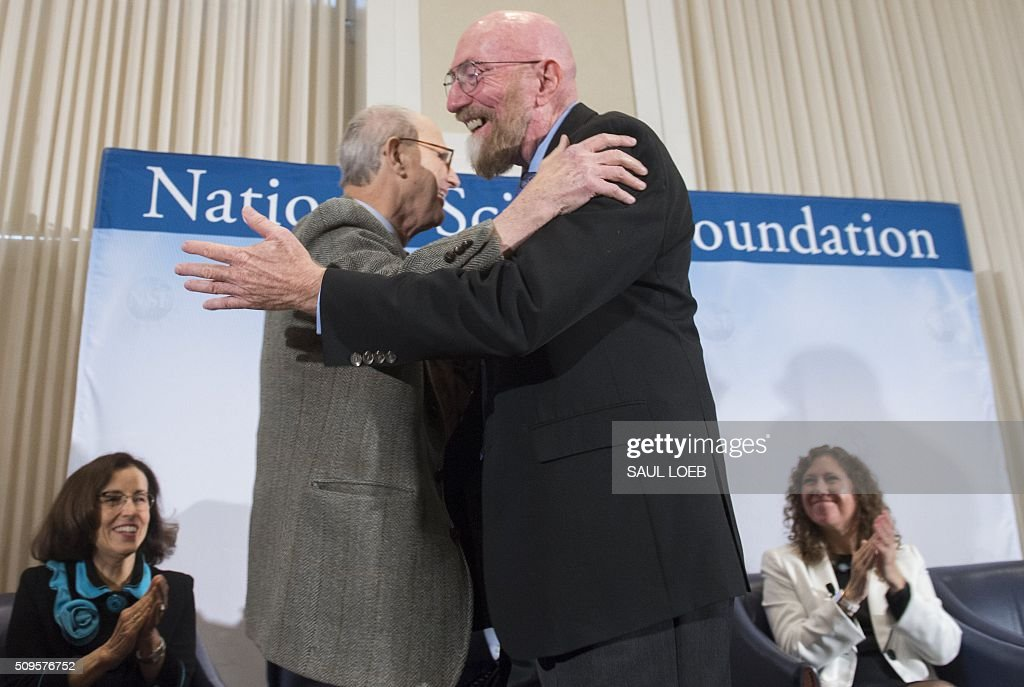 LIGO co-founders Kip Thorne (R), and Rainer Weiss (L), embrace as they announce their discovery, observing the ripples in the fabric of spacetime called gravitational waves for the first time, confirming a prediction by Albert Einstein's theory of relativity, during a press conference at the National Press Club in Washington, DC, February 11, 2016. The machines that gave scientists their first-ever glimpse at gravitational waves are the most advanced detectors ever built for sensing tiny vibrations in the universe.The two US-based underground detectors are known as the Laser Interferometer Gravitational-wave Observatory, or LIGO for short. LOEB