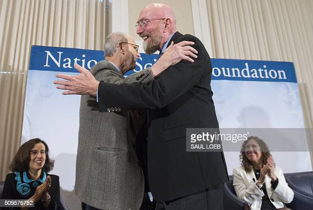 LIGO cofounders Kip Thorne and Rainer Weiss embrace as they announce their discovery observing the ripples in the fabric of spacetime called...