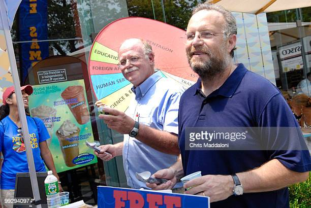 Cofounders of Ben and Jerry's Ice Cream Ben Cohen and Jerry Greenfield scoop 'American Pie' ice cream at the Eastern Market location to promote their...