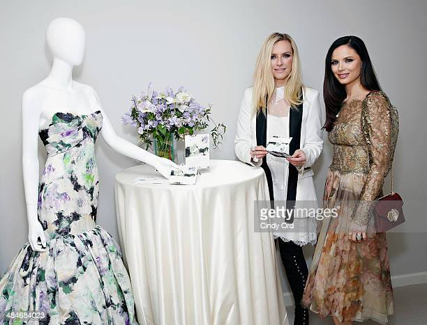 CoFounders of fashion label Marchesa Keren Craig and Georgina Chapman stand next to the gown that inspired Wedding Paper Divas bridal stationery...