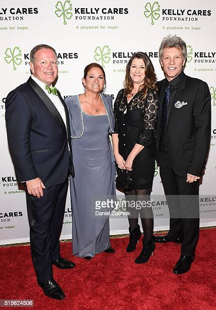 Cofounders of Kelly Cares Brian Kelly and Paqui Kelly pose with Dorothea Hurley and musician Jon Bon Jovi during the Kelly Cares Foundation 2016...