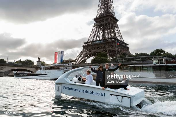 Cofounders of Sea Bubbles company Swedish Anders Bringdal and French Alain Thebault stand with Mayor of Paris Anne Hidalgo on board a Bubble electric...