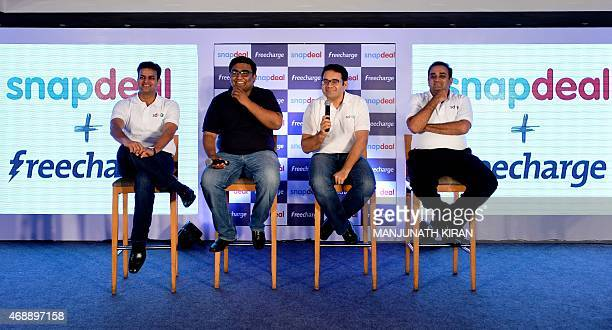 Cofounders of Snapdeal COO Rohit Bansal and CEO Kunal Bahl address the media with the cofounders of FreeCharge CEO Kunal Shah and Sandeep Tandon...