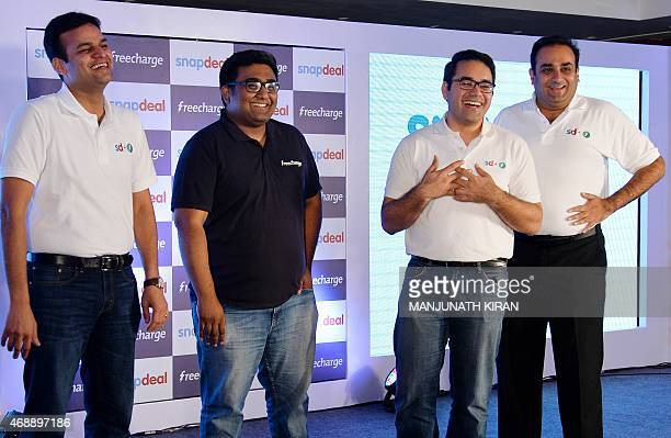 Cofounders of Snapdeal COO Rohit Bansal and CEO Kunal Bahl pose with the cofounder of FreeCharge CEO Kunal Shah and Sandeep Tandon after a press...