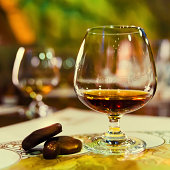 glass of aged cognac and chocolate on a table