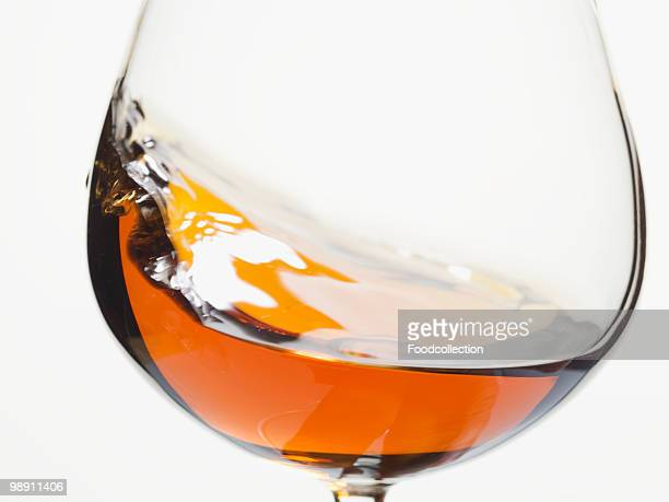 Cognac swirling in glass.