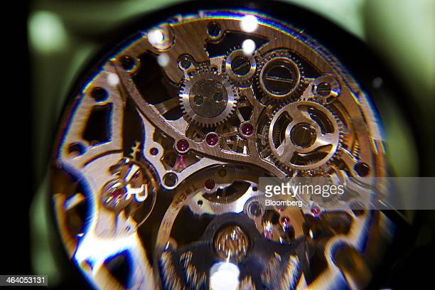 Cogs are seen through a magnifying glass on an ultrathin mechanical selfwinding Skeleton Movement 1200S Piaget luxury wrist watch a watchmaking unit...