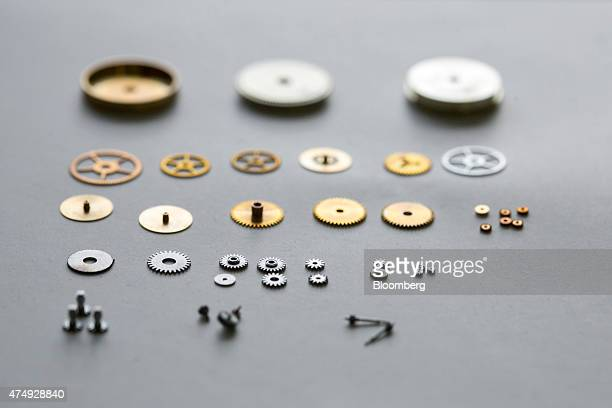 Cogs pinions and toothed wheels sit on a work bench during luxury wristwatch manufacture at Moritz Grossmann GmbH watchmakers in Glasshuette Germany...