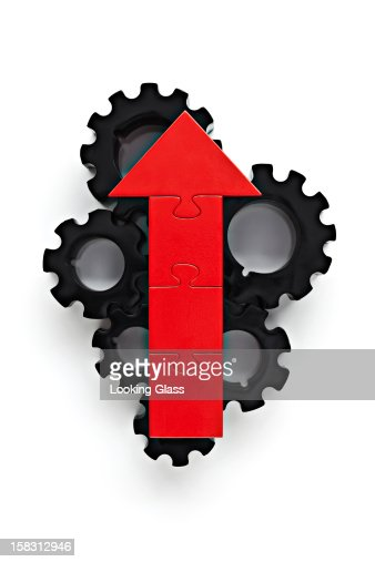 Cogs with red arrow on top