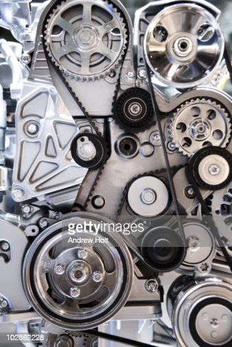 Cogwheels and drive belts of motor car : Stock Photo