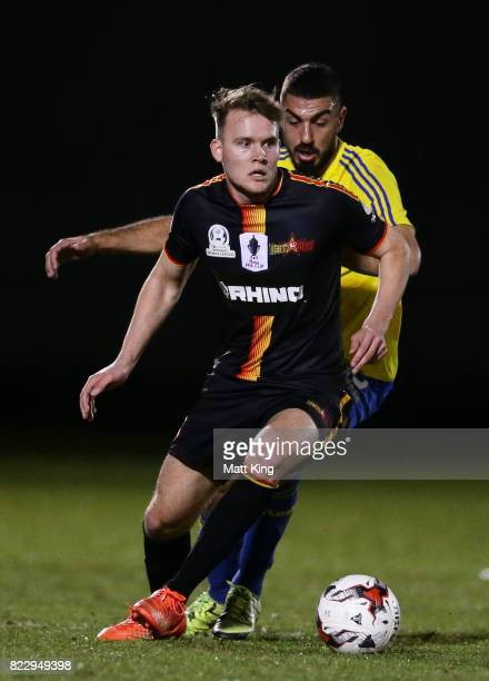 Cohan Morris of the MetroStars is challenged by Perry Moustakas of the Bankstown Berries during the FFA Cup round of 32 match between Bankstown...