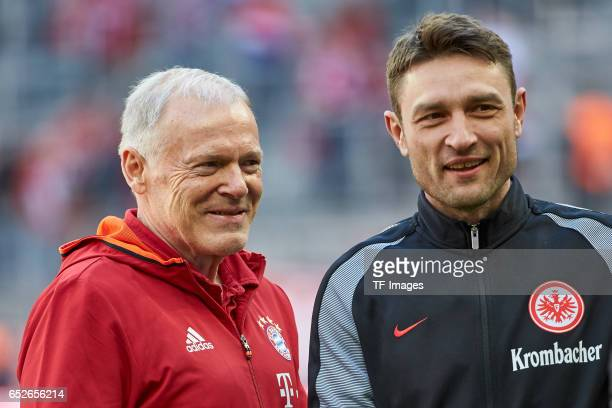 CoHead coach Hermann Gerland of Muenchen and CoHead coach Robert Kovac of Frankfurt looks on during the Bundesliga match between Bayern Muenchen and...