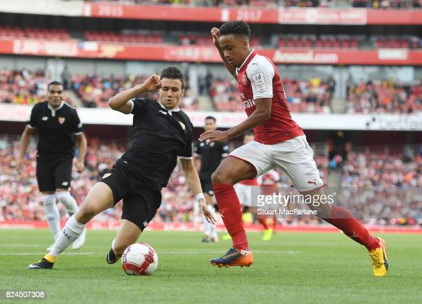 Cohen Bramall of Arsenal takes on Sebastien Corchia of Seville during the Emirates Cup match between Arsenal and Seville at Emirates Stadium on July...