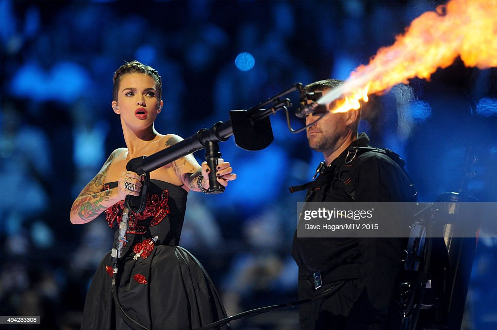 Cohost actress Ruby Rose blows a fire gun on stage during the MTV EMA's 2015 at the Mediolanum Forum on October 25 2015 in Milan Italy