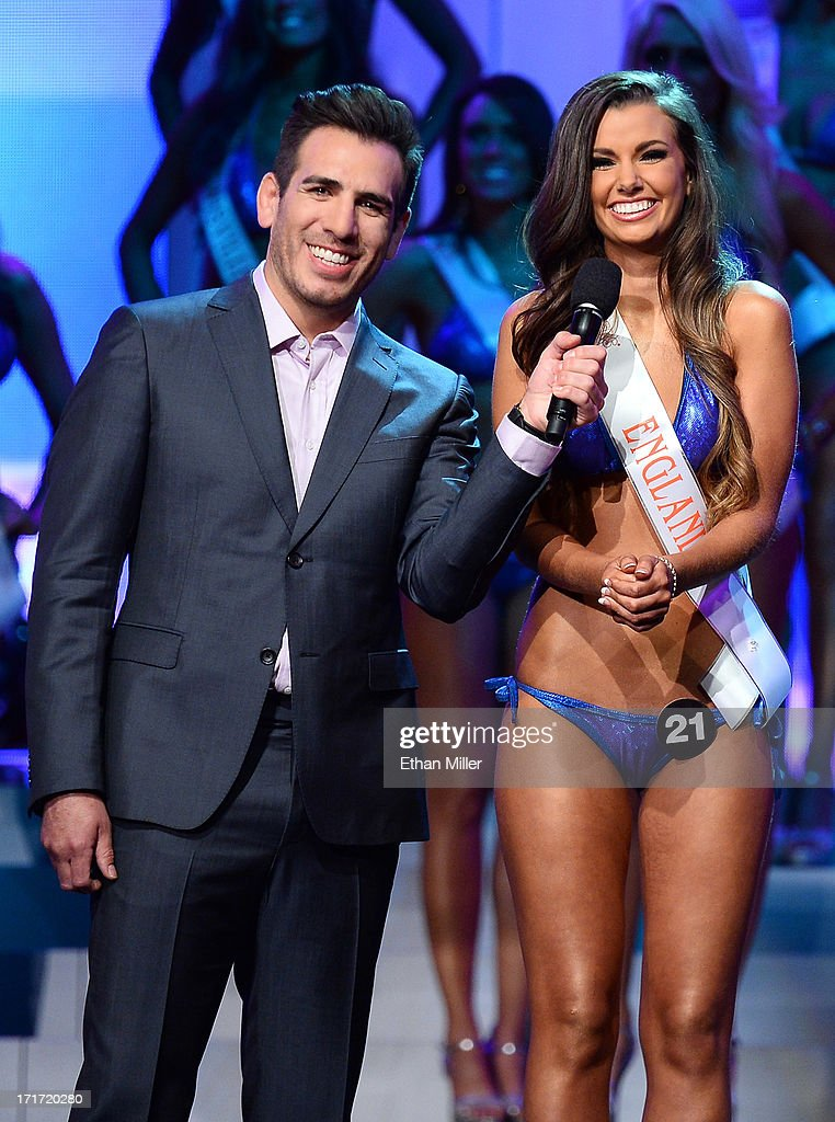 Co-host and former mixed martial artist <a gi-track='captionPersonalityLinkClicked' href=/galleries/search?phrase=Kenny+Florian&family=editorial&specificpeople=4453190 ng-click='$event.stopPropagation()'>Kenny Florian</a> (L) holds a microphone as Lydia Hipkiss of England answers a question during the interview portion of the 17th annual Hooters International Swimsuit Pageant at The Joint inside the Hard Rock Hotel & Casino on June 27, 2013 in Las Vegas, Nevada. Hipkiss went on to be named the second runner-up.