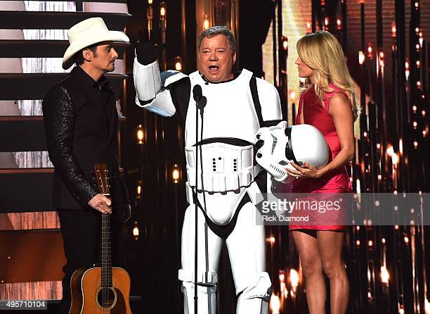 Cohost Brad Paisley actor William Shatner and cohost Carrie Underwood speak onstage at the 49th annual CMA Awards at the Bridgestone Arena on...