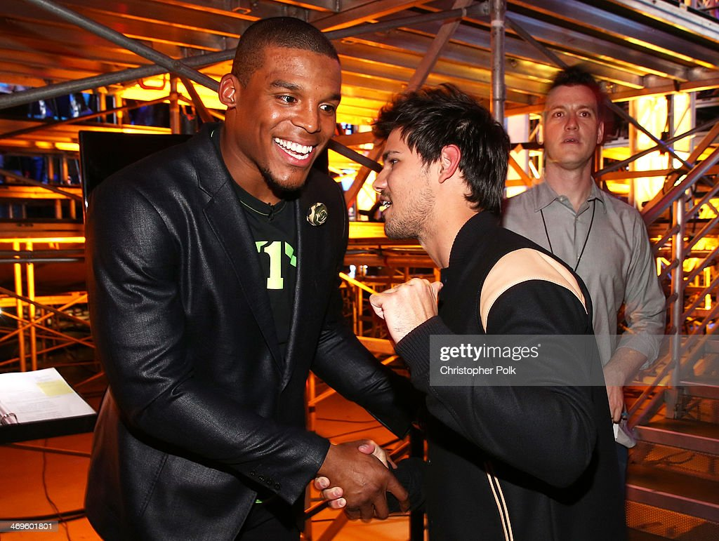 Co-host Cam Newton (L) and actor Taylor Lautner attend Cartoon Network's fourth annual Hall of Game Awards at Barker Hangar on February 15, 2014 in Santa Monica, California.